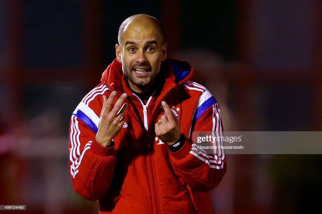 Josep Guardiola, head coach of Bayern Muenchen reacts during a training session at Bayern Muenchen's trainings ground Saebener Strasse on November 17, 2014 in Munich, Germany.