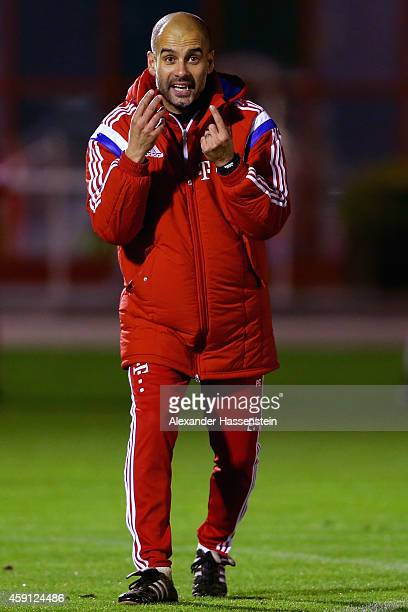 Josep Guardiola head coach of Bayern Muenchen reacts during a training session at Bayern Muenchen's trainings ground Saebener Strasse on November 17...