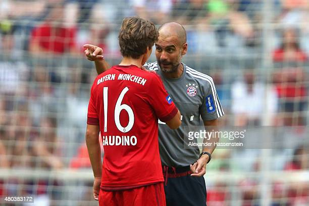 Josep Guardiola head coach of Bayern Muenchen reacts to his player Gianluca Gaudino during a training session after the FC Bayern Muenchen season...