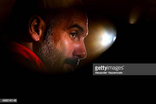Josep Guardiola head coach of Bayern Muenchen talks to the media during a press conference on the eve of their UEFA Champions League match against...