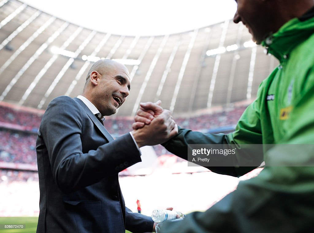 Josep Guardiola head coach of Bayern Munich greets Andre Schubert head coach of Borussia Monchengladbach before the Bundesliga match between FC Bayern Muenchen and Borussia Moenchengladbach on April 30, 2016 in Munich, Bavaria.