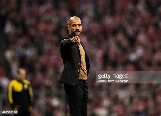 Josep Guardiola head coach of Bayern Munich in action during the Bundesliga match between FC Bayern Muenchen and Borussia Dortmund at Allianz Arena...