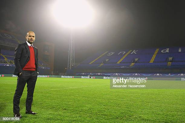 Josep Guardiola head coach of FC Bayern Muenchen alks on the field of play prior to a FC Bayern Muenchen press conference on the eve of their UEFA...