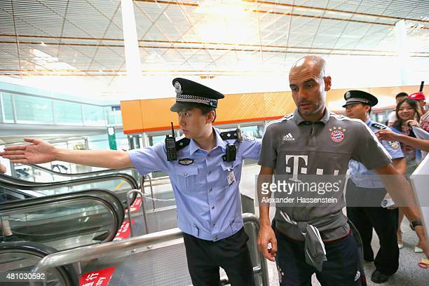 Josep Guardiola head coach of FC Bayern Muenchen arrives with the team at Beijing Capital Airport for the FC Bayern Audi China Summer PreSeason Tour...