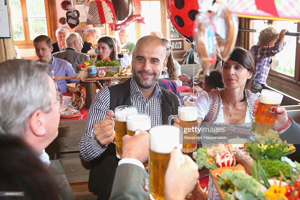 Josep Guardiola, head coach of FC Bayern Muenchen attends with his wife Cristina Guardiola and Bayern Muenchen president Karl Hopfner (L) the Oktoberfest 2015 Beerfestival at Kaefer Wiesenschaenke at Theresienwiese on September 30, 2015 in Munich, Germany.