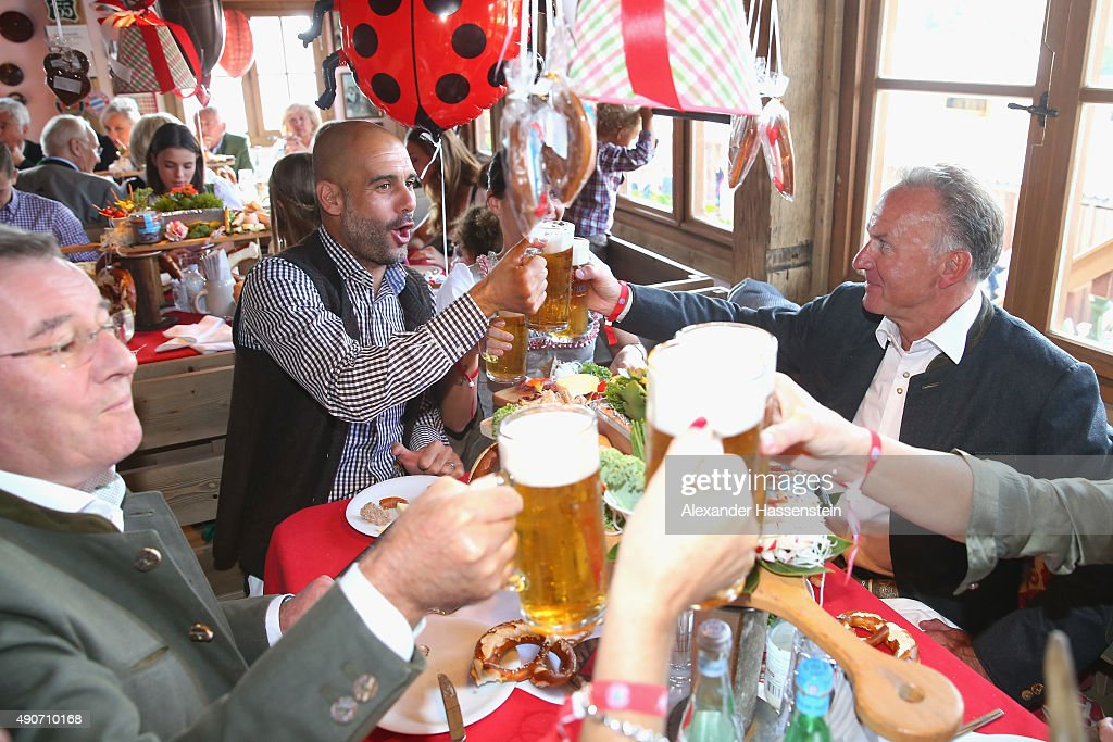 Josep Guardiola, head coach of FC Bayern Muenchen attends with his wife Cristina Guardiola, Bayern Muenchen president Karl Hopfner (L) and Bayern Muenchen CEO Karl-Heinz Rummeingge (R) the Oktoberfest 2015 Beerfestival at Kaefer Wiesenschaenke at Theresienwiese on September 30, 2015 in Munich, Germany.