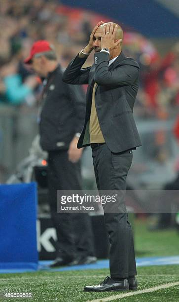 Josep Guardiola head coach of FC Bayern Muenchen celebrates his team's fifth goal duirng the Bundesliga match between FC Bayern Muenchen and VfL...