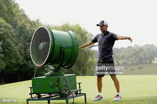 Josep Guardiola head coach of FC Bayern Muenchen cools himself with a fan at tee 7 at the Audi quattro Cup 2015 at Sheshan Golf Club during day 4 of...