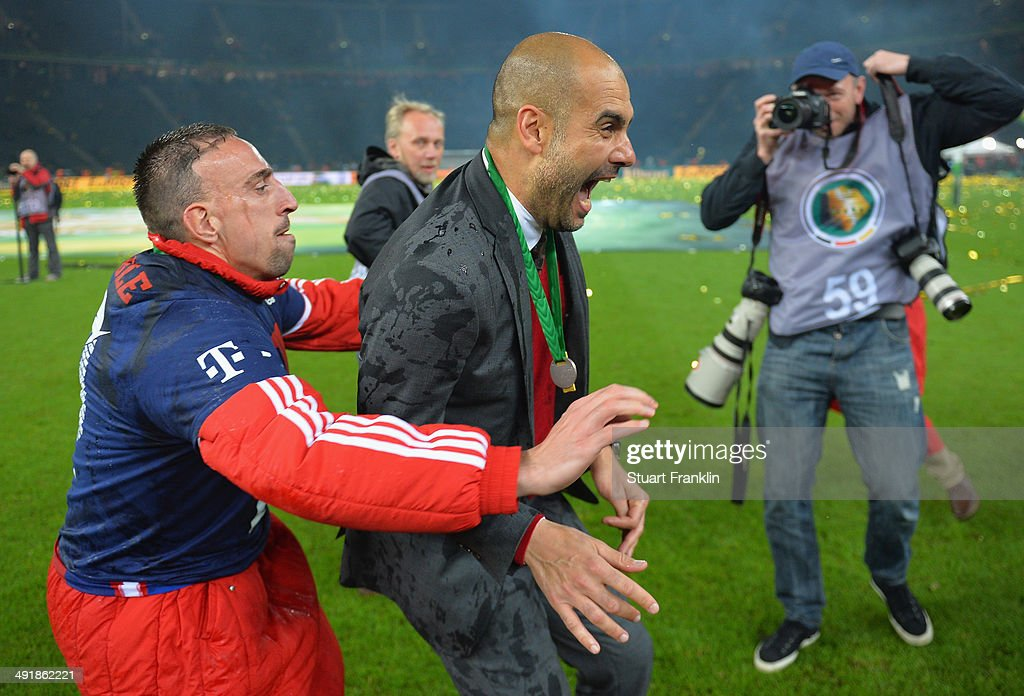 <a gi-track='captionPersonalityLinkClicked' href=/galleries/search?phrase=Josep+Guardiola&family=editorial&specificpeople=2088964 ng-click='$event.stopPropagation()'>Josep Guardiola</a>, head coach of FC Bayern Muenchen gets hugged by <a gi-track='captionPersonalityLinkClicked' href=/galleries/search?phrase=Franck+Ribery&family=editorial&specificpeople=490869 ng-click='$event.stopPropagation()'>Franck Ribery</a> after winning the DFB Pokal between FC Bayern Muenchen and Dortmund at Olympiastadion on May 17, 2014 in Berlin, Germany.