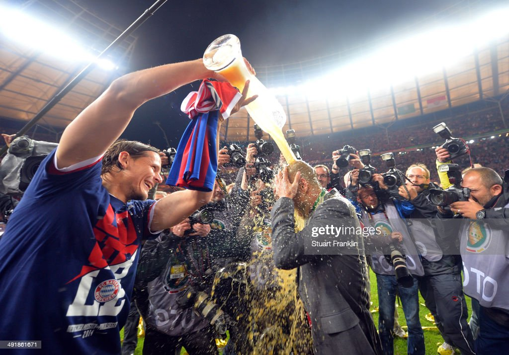 <a gi-track='captionPersonalityLinkClicked' href=/galleries/search?phrase=Josep+Guardiola&family=editorial&specificpeople=2088964 ng-click='$event.stopPropagation()'>Josep Guardiola</a>, head coach of FC Bayern Muenchen gets showered in beer by <a gi-track='captionPersonalityLinkClicked' href=/galleries/search?phrase=Daniel+van+Buyten&family=editorial&specificpeople=213252 ng-click='$event.stopPropagation()'>Daniel van Buyten</a> after winning the DFB Pokal between FC Bayern Muenchen and Dortmund at Olympiastadion on May 17, 2014 in Berlin, Germany.
