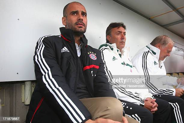 Josep Guardiola head coach of FC Bayern Muenchen looks on with his assistent coaches Domenec Torrent and Hermann Gerland during the friendly match...