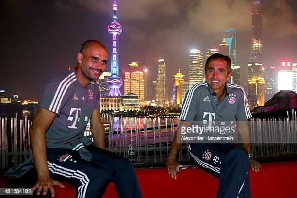 Josep Guardiola head coach of FC Bayern Muenchen looks on with Manuel Estiarte at the Audi quattro Cup 2015 Night Gala at Bar Rouge Shanghai The Bund...