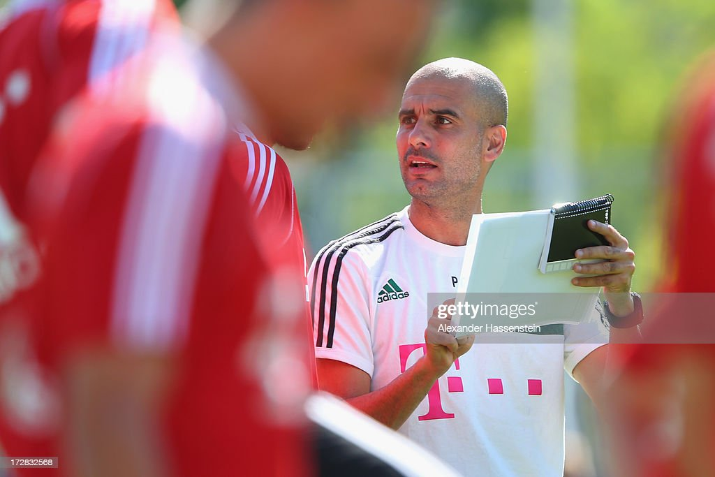 <a gi-track='captionPersonalityLinkClicked' href=/galleries/search?phrase=Josep+Guardiola&family=editorial&specificpeople=2088964 ng-click='$event.stopPropagation()'>Josep Guardiola</a>, head coach of FC Bayern Muenchen reacts during a training session at Campo Sportivo on July 5, 2013 in Arco, Italy.