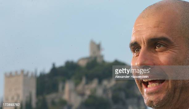 Josep Guardiola head coach of FC Bayern Muenchen smiles in front of the Arco castel after the friendly match between Paulaner Traumelf and FC Bayern...