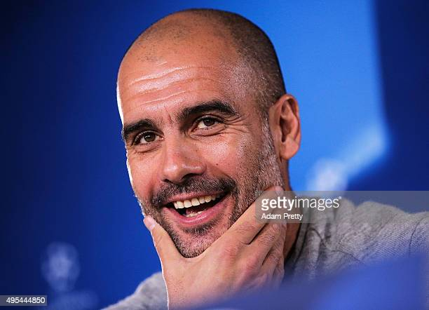 Josep Guardiola head coach of FC Bayern Muenchen speaks to the media during the FC Bayern Muenchen Press Conference at the FC Bayern training grounds...