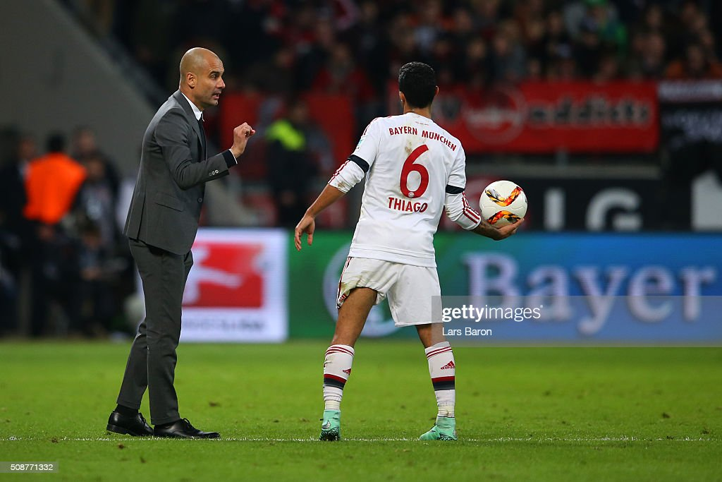 <a gi-track='captionPersonalityLinkClicked' href=/galleries/search?phrase=Josep+Guardiola&family=editorial&specificpeople=2088964 ng-click='$event.stopPropagation()'>Josep Guardiola</a>, Head Coach of FC Bayern Muenchen speaks with Thiago of FC Bayern Muenchen during the Bundesliga match between Bayer Leverkusen and FC Bayern Muenchen at BayArena on February 6, 2016 in Leverkusen, Germany.