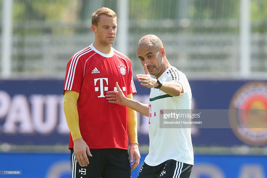 <a gi-track='captionPersonalityLinkClicked' href=/galleries/search?phrase=Josep+Guardiola&family=editorial&specificpeople=2088964 ng-click='$event.stopPropagation()'>Josep Guardiola</a>, head coach of FC Bayern Muenchen talks to his keeper <a gi-track='captionPersonalityLinkClicked' href=/galleries/search?phrase=Manuel+Neuer&family=editorial&specificpeople=764621 ng-click='$event.stopPropagation()'>Manuel Neuer</a> during a training session at Campo Sportivo on July 5, 2013 in Arco, Italy.