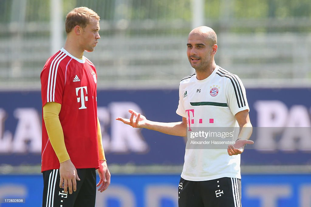 Josep Guardiola, head coach of FC Bayern Muenchen talks to his keeper Manuel Neuer during a training session at Campo Sportivo on July 5, 2013 in Arco, Italy.