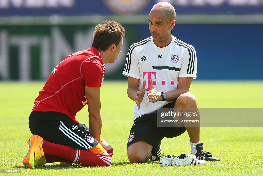 Josep Guardiola, head coach of FC Bayern Muenchen talks to his player Mario Mandzukic during a training session at Campo Sportivo on July 5, 2013 in Arco, Italy.