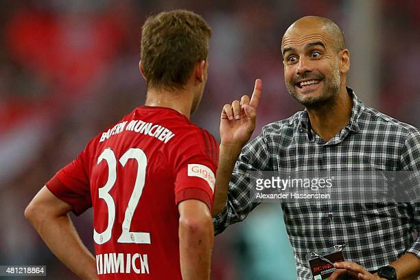 Josep Guardiola head coach of FC Bayern Muenchen talks to his player Joshua Kimmich during the international friendly match between FC Bayern...
