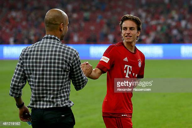 Josep Guardiola head coach of FC Bayern Muenchen talks to his player Gianluca Gaudino during the international friendly match between FC Bayern...