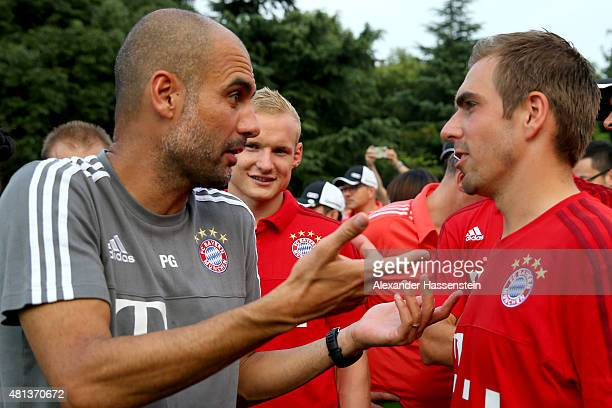 Josep Guardiola head coach of FC Bayern Muenchen talks to his player Philipp Lahm after the Audi quattro Cup 2015 at Sheshan Golf Club during day 4...