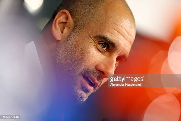 Josep Guardiola head coach of FC Bayern Muenchen talks to the media during a FC Bayern Muenchen press conference on the eve of their UEFA Champions...