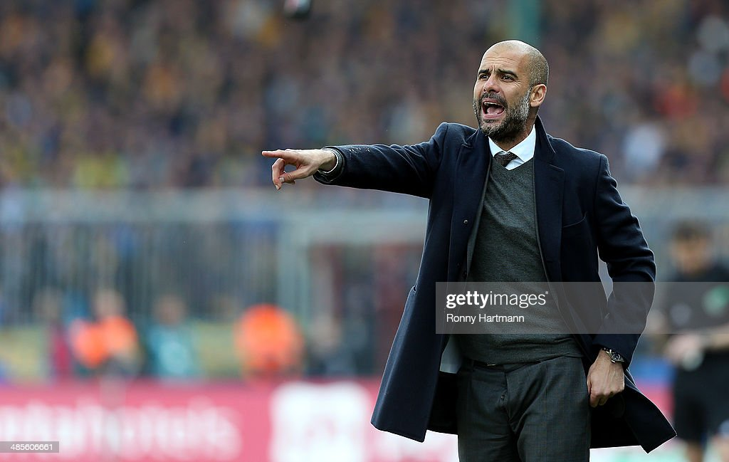 <a gi-track='captionPersonalityLinkClicked' href=/galleries/search?phrase=Josep+Guardiola&family=editorial&specificpeople=2088964 ng-click='$event.stopPropagation()'>Josep Guardiola</a>, head coach of Muenchen, gestures during the Bundesliga match between Eintracht Braunschweig and FC Bayern Muenchen at Eintracht Stadion on April 19, 2014 in Braunschweig, Germany.