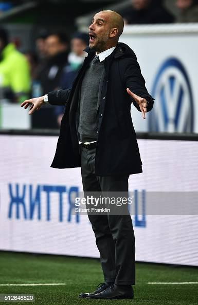 Josep Guardiola head coach of Muenchen gestures during the Bundesliga match between VfL Wolfsburg and FC Bayern Muenchen at Volkswagen Arena on...