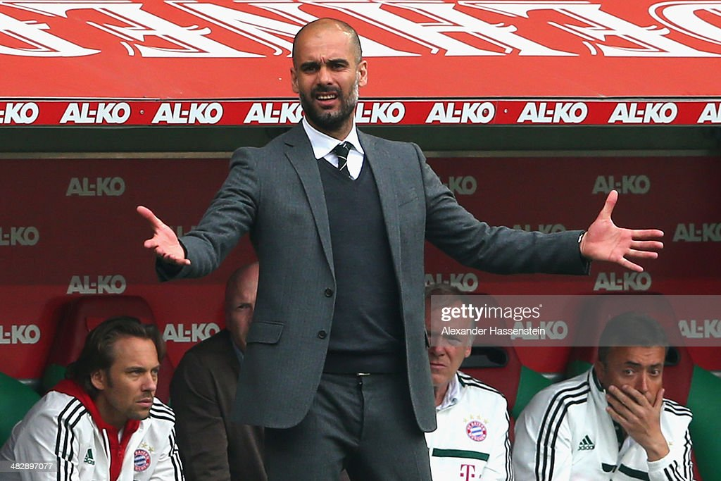 Josep Guardiola, head coach of Muenchen reacts during the Bundesliga match between FC Augsburg and FC Bayern Muenchen at SGL Arena on April 5, 2014 in Augsburg, Germany.