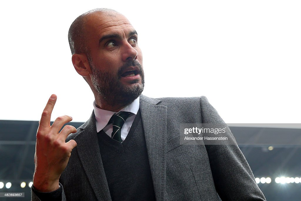 Josep Guardiola, head coach of Muenchen reacts prior to the Bundesliga match between FC Augsburg and FC Bayern Muenchen at SGL Arena on April 5, 2014 in Augsburg, Germany.
