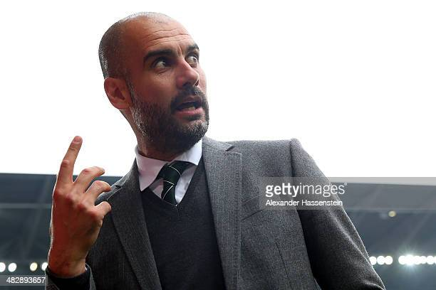 Josep Guardiola head coach of Muenchen reacts prior to the Bundesliga match between FC Augsburg and FC Bayern Muenchen at SGL Arena on April 5 2014...