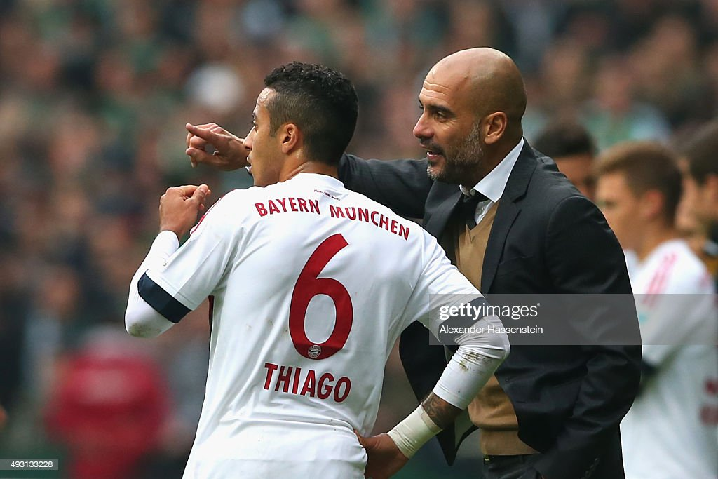 <a gi-track='captionPersonalityLinkClicked' href=/galleries/search?phrase=Josep+Guardiola&family=editorial&specificpeople=2088964 ng-click='$event.stopPropagation()'>Josep Guardiola</a>, head coach of Muenchen reacts to his player Thiago during the Bundesliga match between SV Werder Bremen and FC Bayern Muenchen at Weserstadion on October 17, 2015 in Bremen, Germany.