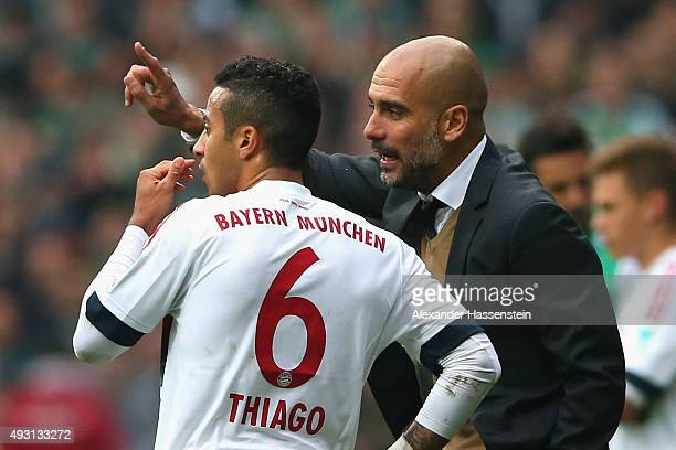Josep Guardiola head coach of Muenchen reacts to his player Thiago during the Bundesliga match between SV Werder Bremen and FC Bayern Muenchen at...