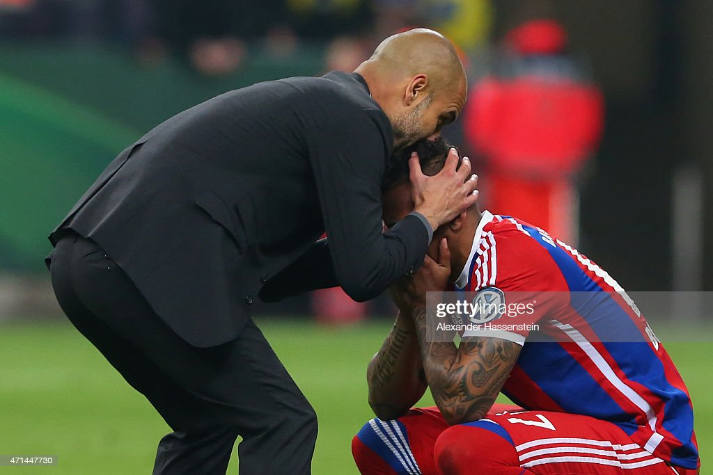 Josep Guardiola, head coach of Muenchen reacts with his player Jerome Boateng after the DFB Cup Semi Final match between FC Bayern Muenchen and Borussia Dortmund at Allianz Arena on April 28, 2015 in Munich, Germany.
