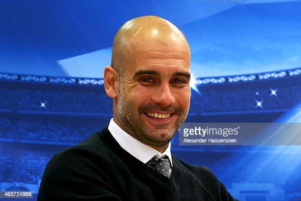 Josep Guardiola head coach of Muenchen smiles during a press conference after the UEFA Champions League round of 16 first leg match between FC...