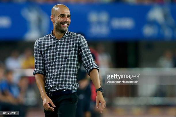 Josep Guardiola head coach of Muenchen smiles during the international friendly match between FC Guangzhou Evergrande Taobao FC and FC Bayern...