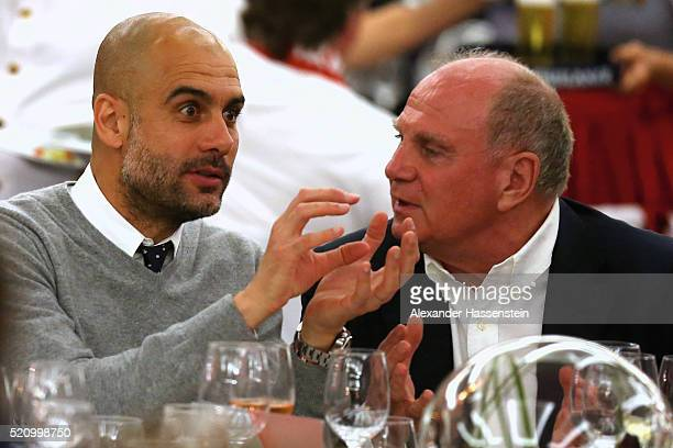 Josep Guardiola head coach of Muenchen talks to Uli Hoeness during the Champions Banquette at EPIC SANA Lisboa Hotel after winning the UEFA Champions...