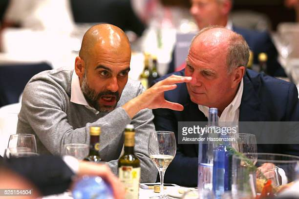 Josep Guardiola head coach of Muenchen talks to Uli Hoeness during the Champions Banquette after the UEFA Champions League semi final first leg match...