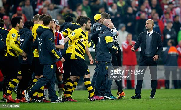 Josep Guardiola head coach of Muenchen wants to congratulate head coach Juergen Klopp of Dortmund and his team on victory after the DFB Cup semi...