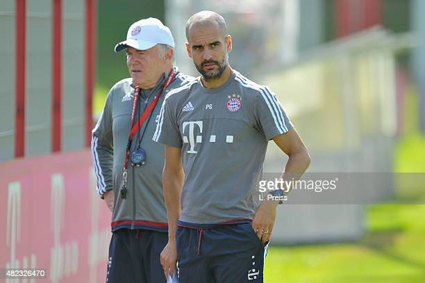 Josep Guardiola head coach talks to assistant coach Hermann Gerland during a training session of FC Bayern Muenchen at Saebener Strasse training...