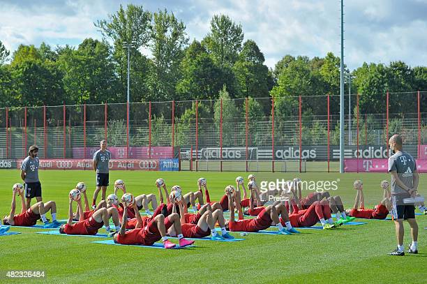 Josep Guardiola head coach watches a training session of FC Bayern Muenchen at Saebener Strasse training ground on July 30 2015 in Munich Germany