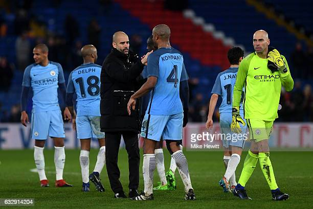 Josep Guardiola Manager oaf Manchester City and Vincent Kompany of Manchester City celebrate during the Emirates FA Cup Fourth Round match between...