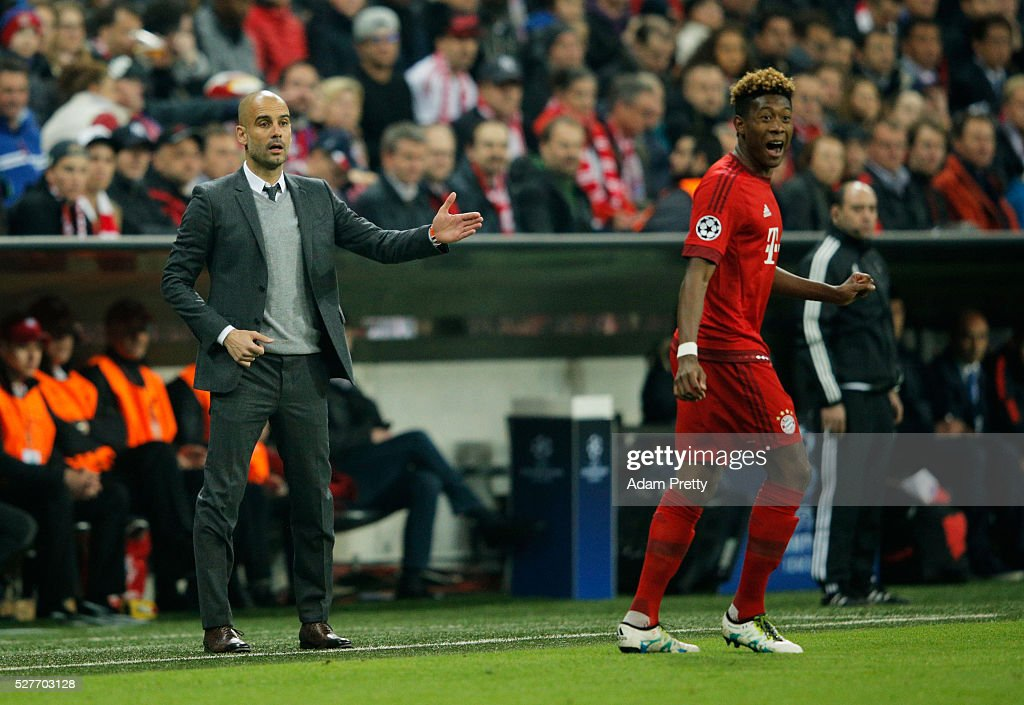 Josep Guardiola manager of Bayern Munich and David Alaba of Bayern Munich look on during UEFA Champions League semi final second leg match between FC Bayern Muenchen and Club Atletico de Madrid at Allianz Arena on May 3, 2016 in Munich, Germany.