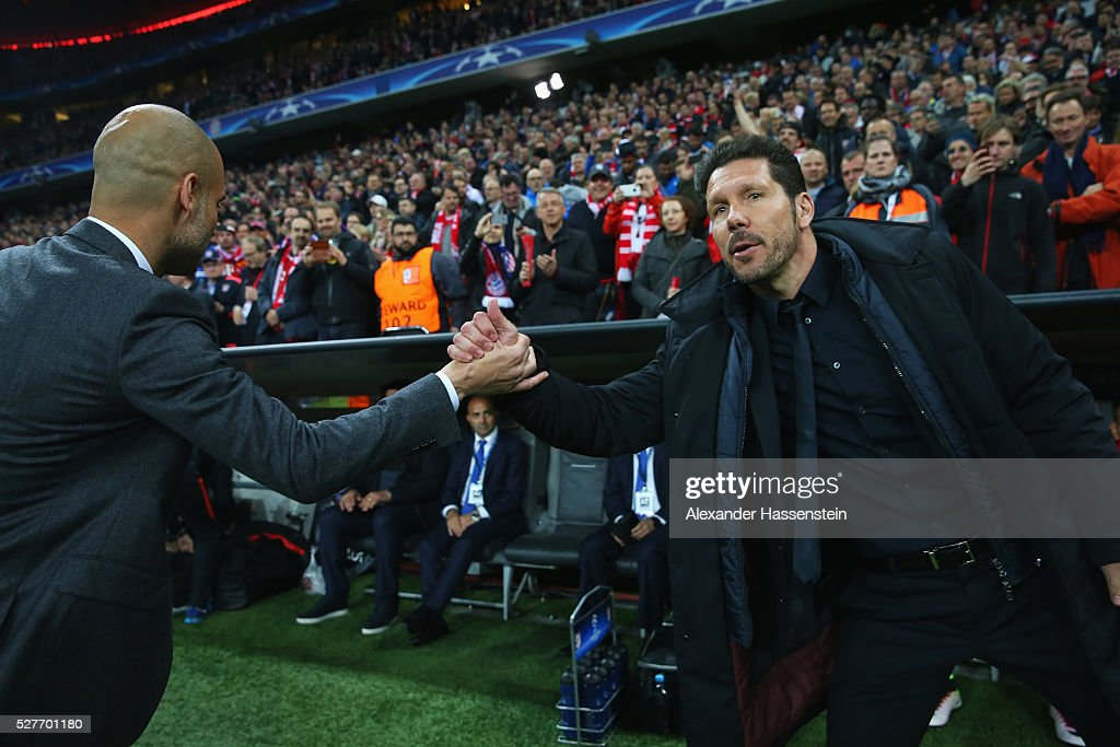 <a gi-track='captionPersonalityLinkClicked' href=/galleries/search?phrase=Josep+Guardiola&family=editorial&specificpeople=2088964 ng-click='$event.stopPropagation()'>Josep Guardiola</a> manager of Bayern Munich and <a gi-track='captionPersonalityLinkClicked' href=/galleries/search?phrase=Diego+Simeone&family=editorial&specificpeople=226872 ng-click='$event.stopPropagation()'>Diego Simeone</a> head coach of Atletico Madrid shake hands prior to the UEFA Champions League semi final second leg match between FC Bayern Muenchen and Club Atletico de Madrid at Allianz Arena on May 3, 2016 in Munich, Germany.