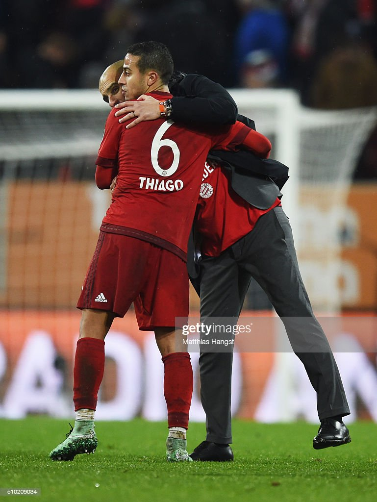<a gi-track='captionPersonalityLinkClicked' href=/galleries/search?phrase=Josep+Guardiola&family=editorial&specificpeople=2088964 ng-click='$event.stopPropagation()'>Josep Guardiola</a> manager of Bayern Munich celebrates victory with Thiago Alcantara of Bayern Munich after the Bundesliga match between FC Augsburg and FC Bayern Muenchen at SGL Arena on February 14, 2016 in Augsburg, Germany.