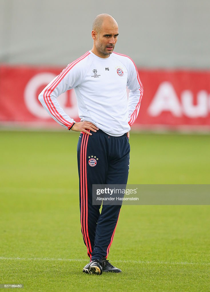 Josep Guardiola manager of Bayern Munich looks thoughtful during a FC Bayern Muenchen training session ahead of their UEFA Champions League semi final second leg match against Club Atletico de Madrid at the Saebener Strasse training ground on May 2, 2016 in Munich, Germany.