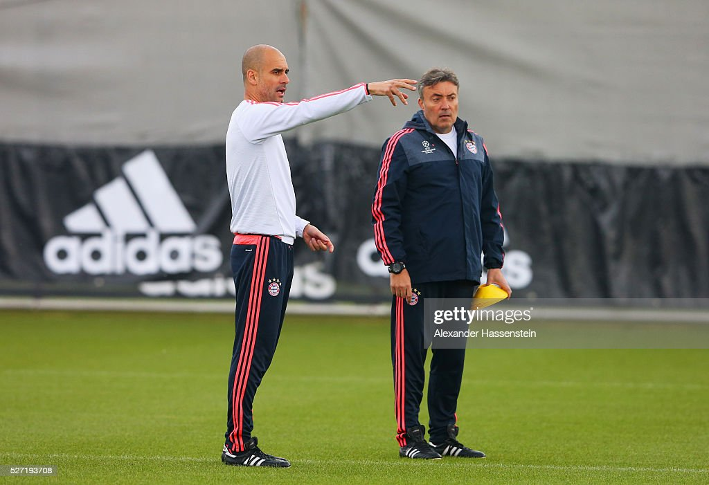 Josep Guardiola manager of Bayern Munich (L) signals during a FC Bayern Muenchen training session ahead of their UEFA Champions League semi final second leg match against Club Atletico de Madrid at the Saebener Strasse training ground on May 2, 2016 in Munich, Germany.