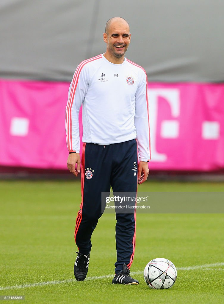 Josep Guardiola manager of Bayern Munich smiles during a FC Bayern Muenchen training session ahead of their UEFA Champions League semi final second leg match against Club Atletico de Madrid at the Saebener Strasse training ground on May 2, 2016 in Munich, Germany.
