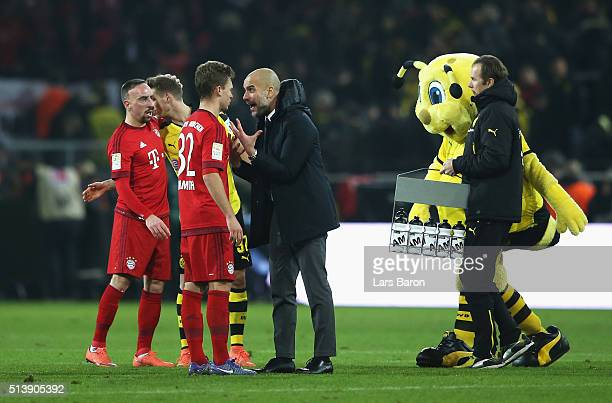 Josep Guardiola manager of Bayern Munich talks to Joshua Kimmich during the Bundesliga match between Borussia Dortmund and FC Bayern Muenchen at...